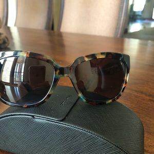 Prada colored tortoiseshell sunglasses